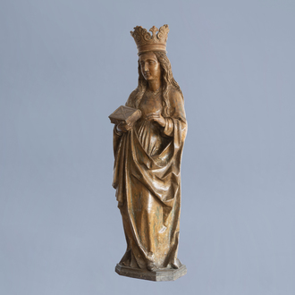 A carved wooden figure of Saint Catherina with traces of polychrome decoration, Southern Netherlands, 16th C.