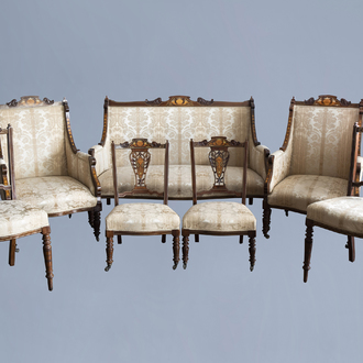 An English seven-piece mahogany salon set with inlay and floral upholstery, 19th/20th C.