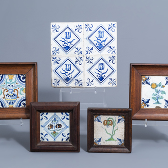Eight Dutch Delft blue, white and polychrome tiles with flowers, 17th C.