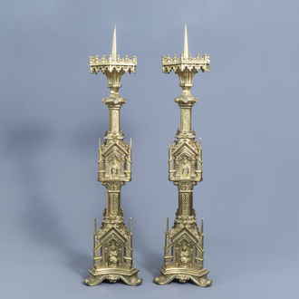 A pair of imposing French Gothic revival gilt brass candlesticks of architectural form, 19th C.