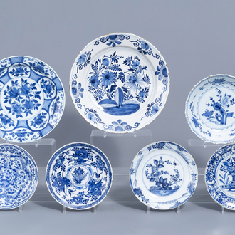 Two Dutch Delft blue and white chargers and five plates with floral design, 18th C.