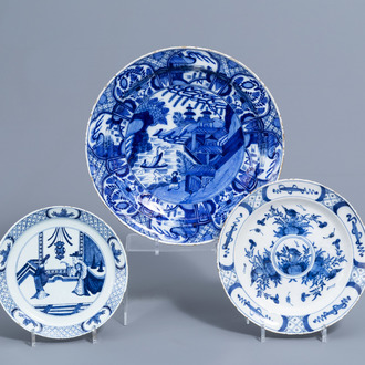 A Dutch Delft blue and white charger and two plates with chinoiserie design, 18th C.