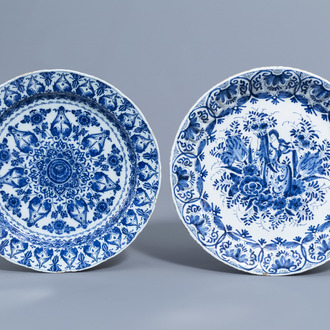 Two Dutch Delft blue and white chargers with a cornucopia and floral design, 18th C.