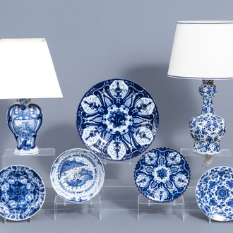 A varied collection of Dutch Delft blue and white pottery with mostly floral design, 18th C.