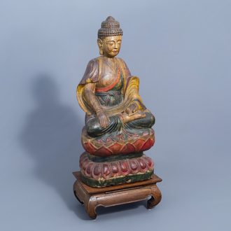 A Chinese polychrome painted wooden figure of Buddha on a lotus throne on a wooden base, 20th C.