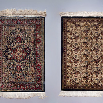 Two Oriental rugs with floral design, silk on cotton, 20th C.