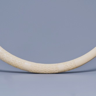 A carved ivory tusk with ornamental design, first half 20th C.