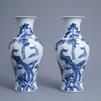 A pair of Chinese blue and white 'phoenix' vases, Republic, 20th C.
