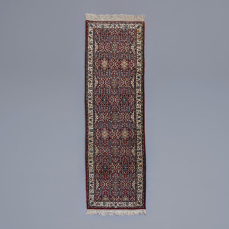 An Oriental runner with floral design, wool on cotton, 20th C.
