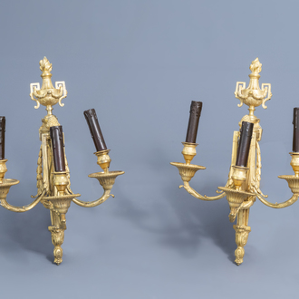 A pair of French Louis XVI three-branch ormolu wall lights in the manner of Jean-Charles Delafosse (1734-1789), 18th C.