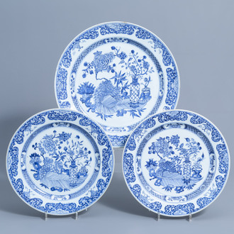 Three Chinese blue and white chargers with antiquities and floral design, Yongzheng