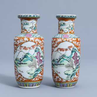 A pair of Chinese famille rose vases with animated river landscapes, 19th C.