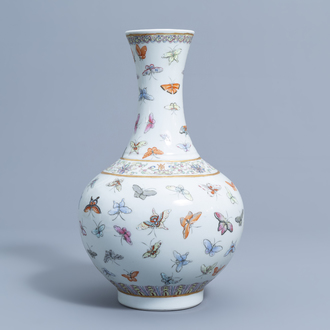 A Chinese famille rose '100 butterflies' bottle vase, Guangxu mark, 20th C.