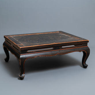 A Chinese black- and red-lacquered wooden 'dragon' table, 19th C.