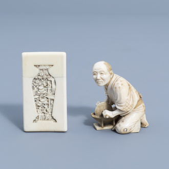 A Chinese richly carved Canton ivory card case and a signed Japanese ivory okimono of a man at work, Meiji, 19th C.