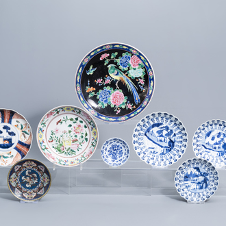 A varied collection of Chinese and Japanese blue, white, famille rose and Imari porcelain and a cloisonné saucer dish, Kangxi and later