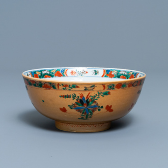 A Chinese capucine brown-ground famille verte bowl, Kangxi