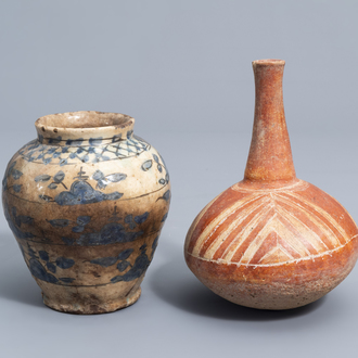 A South American bottle vase and a Syrian or Iranian storage jar with floral design, 19th C. and/or earlier