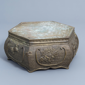 A Japanese bronze hexagonal base with floral design and shishi, Meiji, ca. 1900