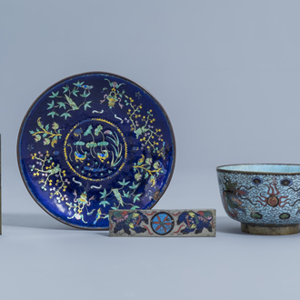 A Chinese cloisonné 'dragons' bowl, an enamel saucer with floral design and two small cloisonné scroll weights, 19th/20th C.