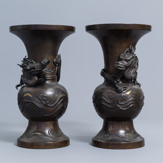 A pair of Japanese bronze relief decorated 'dragon' vases, Meiji, 19th C.