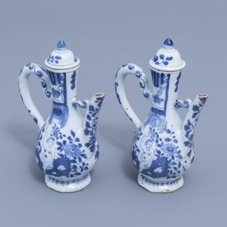 A pair of Chinese blue and white wine jugs with European subject, Kangxi