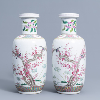 A pair of Chinese famille rose vases with birds among blossoming branches, 20th C.