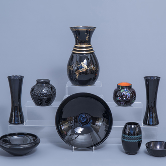 A varied collection of black glass vases and bowls, a.o. Art Deco 'Booms' glass, 20th C.