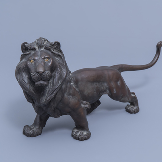 A Japanese bronze sculpture of a lion, probably signed Toku Ya, Meiji, 19th/20th C.