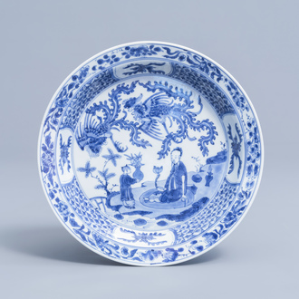 A Chinese blue and white dish with figures and phoenixes in a landscape, Kangxi