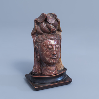 A Chinese carved soapstone bust of Guanyin, 19th C.