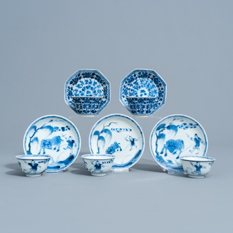 Five Chinese blue and white cups and saucers with floral design and a boy and a buffalo in a landscape, Kangxi/Yongzheng
