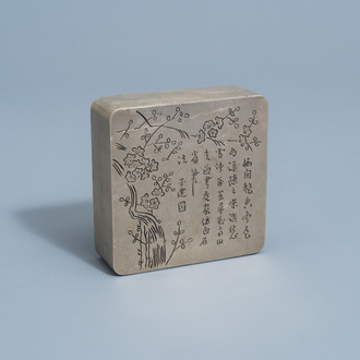 A Chinese square paktong metal scholar's ink box with calligraphy and floral design, marked, 20th C.