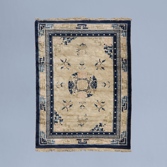 A Chinese 'Peking' rug with floral design, wool on cotton, first half of the 20th C.