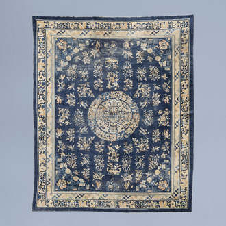 A Chinese Baotou rug with floral design, wool on cotton, first half of the 20th C.