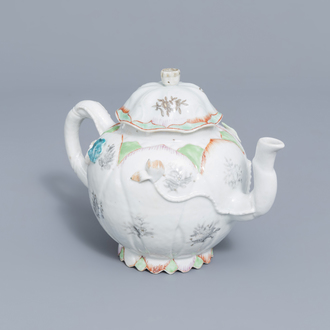 A large Chinese famille rose teapot and cover with floral relief design, Yongzheng