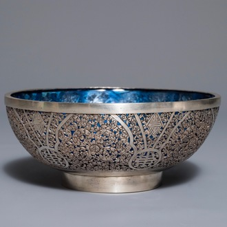 A Chinese reticulated silver bowl with blue glass interior, 19th/20th C.
