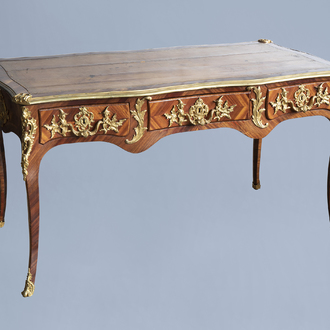 An extremely fine French Louis XV style gilt bronze chinoiserie mounted kingwood bureau plat, mid 18th C.