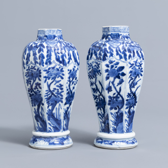A pair of Chinese blue and white vases with floral design, Kangxi