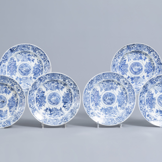 Six Chinese blue and white dishes with floral design and raised central medallion, Kangxi/Yongzheng
