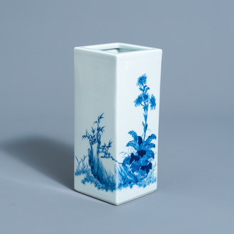 A square Chinese blue and white brush pot with floral design, marked, 20th C.