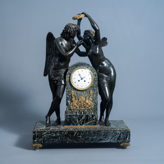 An impressive French patinated and gilt bronze mounted vert de mer marble Empire style mantel clock with Psyche crowning Cupid, 19th/20th C.