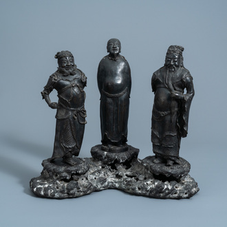 A Chinese bronze group of three figures, seal mark, Ming