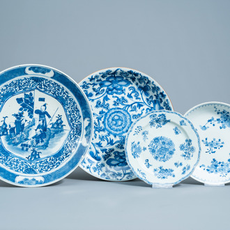 Four various Chinese blue and white chargers and plates with floral design and figures in a landscape, Kangxi and later