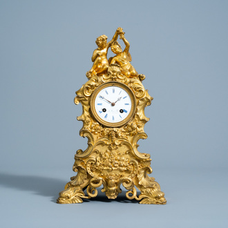 A French gilt bronze mantel clock with bacchantes and the forbidden fruit, 19th C.