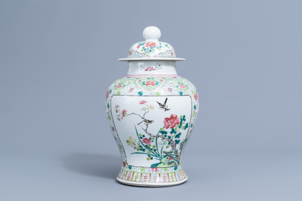 A Chinese famille rose vase and cover with birds among blossoming branches, 19th/20th C.