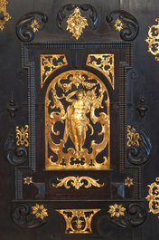 A South-German ebony veneer and gilded copper cabinet, 17th C.