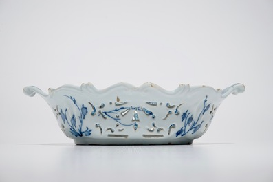 A Dutch Delft blue and white reticulated basket with chinoiserie design, 18th C.