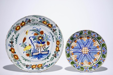 A pair of Dutch Delft polychrome beaker vases and two chargers, 18th C.