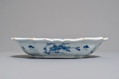 A Dutch Delft blue and white salad bowl with lotus scrolls, 18th C.